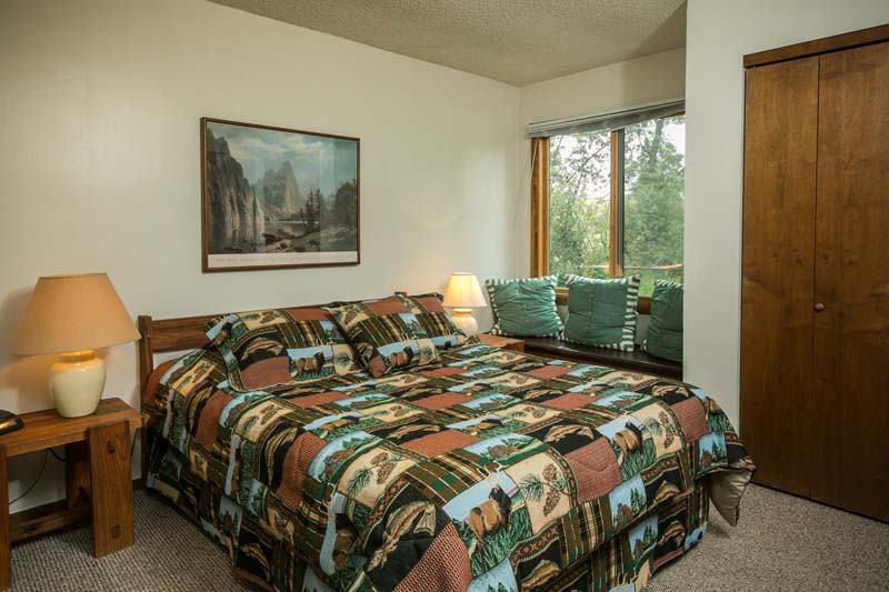Big Horn cabin bedroom with queen bed and window seat.