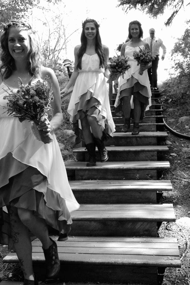 Bridesmaids coming down the stairs from the guest cabins.