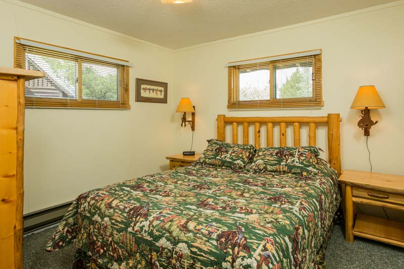 Hiker cabin bedroom with queen bed.