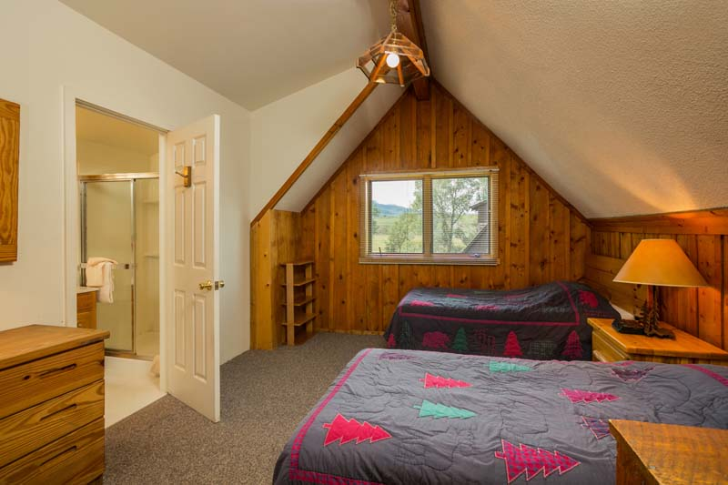 Hiker cabin upstairs bedroom with two queen beds and on suite bathroom.