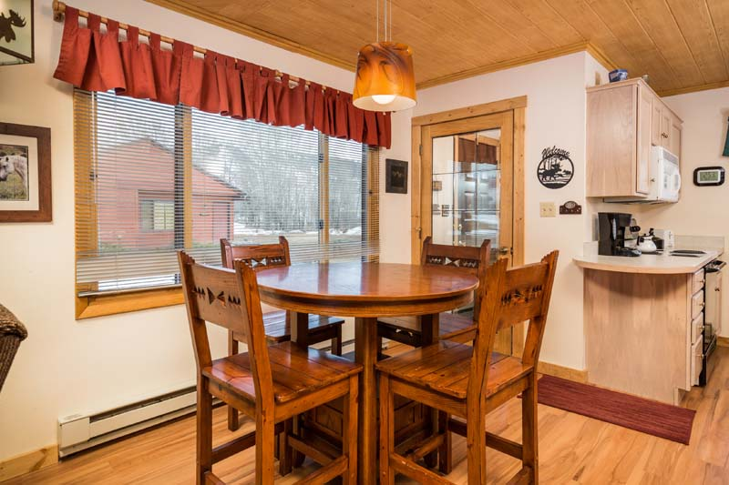 Lost Ranger cabin dining room with high top wood round table.