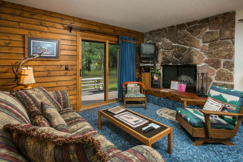 Rainbow cabin living room with fireplace.
