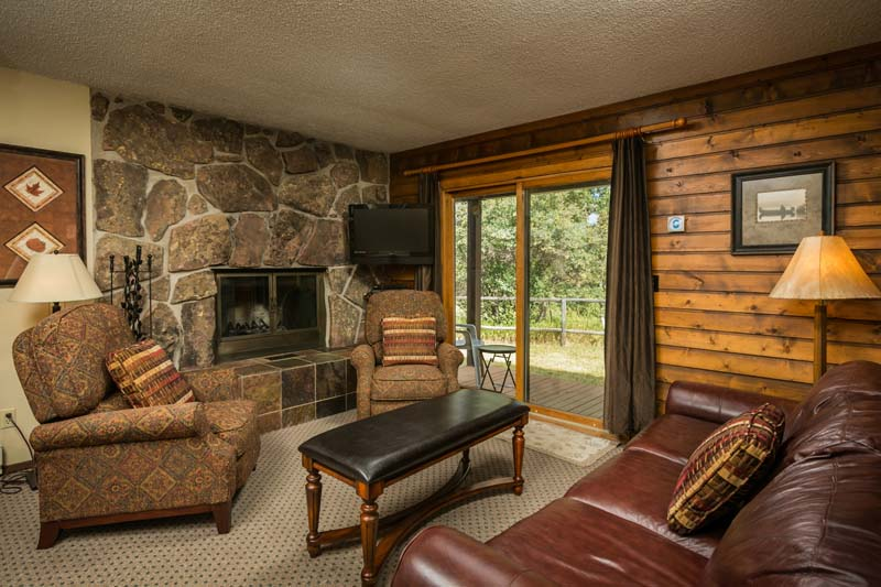 Eagles Nest cabin living room with fireplace.