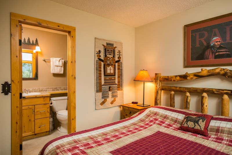 Fireside cabin bedroom with queen bed and on suite bathroom.
