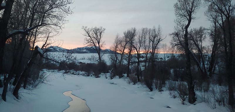 Sun setting over Elk River with alpenglow.
