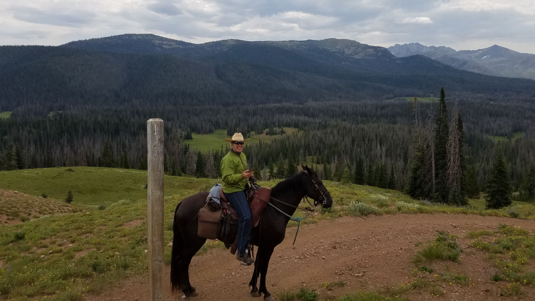 woman on horseback at glen eden resort clark colorado cabin rentals
